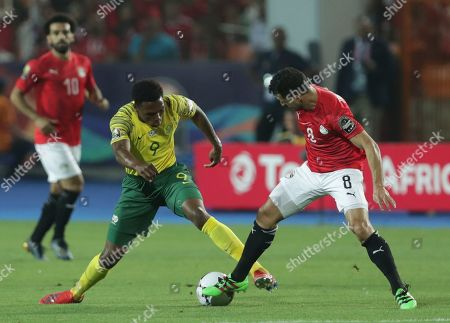 South Africa's Lebo Mothiba, left, and Egypt's Tarek Hamed fight for the ball during the African Cup of Nations round of 16 soccer match between Egypt and South Africa in Cairo International stadium in Cairo, Egypt
