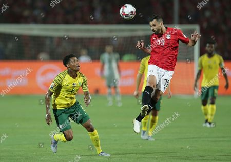 Egypt's Abdallah Said heads the ball in front of South Africa's Bongani Zungu during the African Cup of Nations round of 16 soccer match between Egypt and South Africa in Cairo International stadium in Cairo, Egypt