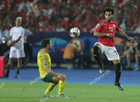 Egypt's Mohamed Salah receives the ball in front of South Africa's Dean Furman during the African Cup of Nations round of 16 soccer match between Egypt and South Africa in Cairo International stadium in Cairo, Egypt