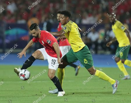 Egypt's Abdallah Said in action in front of South Africa's Bongani Zungu during the African Cup of Nations round of 16 soccer match between Egypt and South Africa in Cairo International stadium in Cairo, Egypt