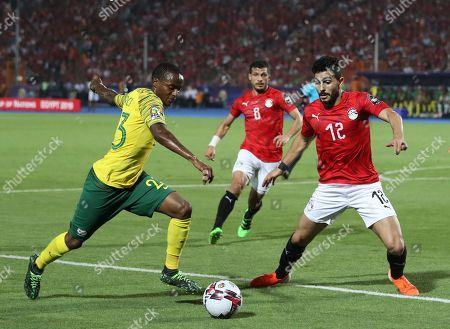 Sa23\ tries to sedn a cross by Egypt's Ayman Ashraf during the African Cup of Nations round of 16 soccer match between Egypt and South Africa in Cairo International stadium in Cairo, Egypt