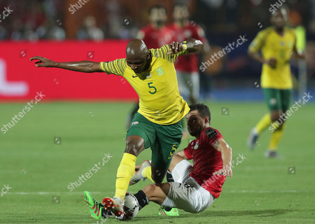 Egypt's Tarek Hamed tackles South Africa's Thamsanqa Mkhize during the African Cup of Nations round of 16 soccer match between Egypt and South Africa in Cairo International stadium in Cairo, Egypt