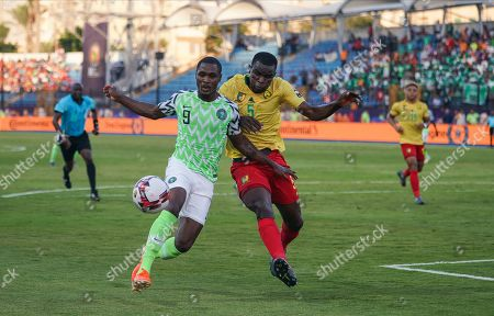 FRANCE OUT Michael Ngadeu Ngadjui of Cameroon and odion Jude Ighalo of Nigeria challenging for the ball during the African Cup of Nations match between Cameroon and Nigeria at the Alexanddria Stadium in Alexandria, Egypt