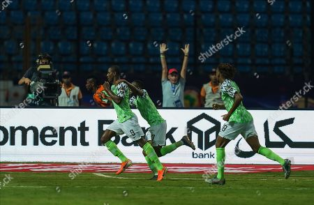 Stock Picture of FRANCE OUT odion Jude Ighalo of Nigeria celebrating scoring to 2-2 during the African Cup of Nations match between Cameroon and Nigeria at the Alexanddria Stadium in Alexandria, Egypt