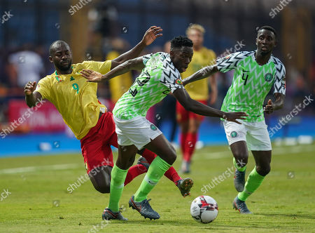 FRANCE OUT Stephane Cedric Bahoken of Cameroon and Kenneth Josiah omeruo of Nigeria challenging for the ball during the African Cup of Nations match between Cameroon and Nigeria at the Alexanddria Stadium in Alexandria, Egypt