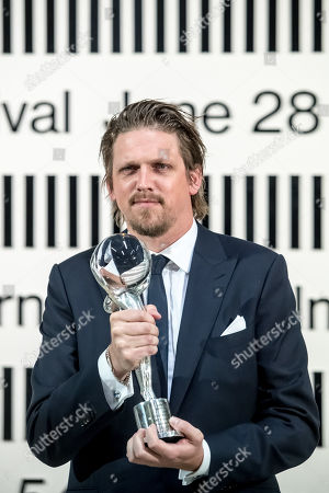 German director Jan-Ole Gerster poses after he received the Official Competition Special Jury Prize for 'Lara' (Lara) during the closing ceremony of the 54th Karlovy Vary International Film Festival in Karlovy Vary, Czech Republic, 06 July 2019.