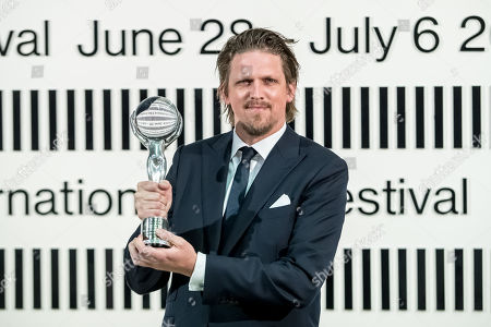 Stock Photo of German director Jan-Ole Gerster poses after he received the Official Competition Special Jury Prize for 'Lara' (Lara) during the closing ceremony of the 54th Karlovy Vary International Film Festival in Karlovy Vary, Czech Republic, 06 July 2019.