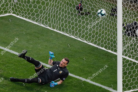 Argentina's goalkeeper Franco Armani fails to stop a penalty from Chile's Arturo Vidal during the Copa America third-place soccer match at the Arena Corinthians in Sao Paulo, Brazil