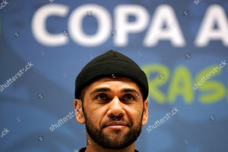 Brazil's Daniel Alves listens to a question during a press conference at the Maracana stadium in Rio de Janeiro, Brazil, . Brazil will face Peru for the Copa America title soccer match on Sunday