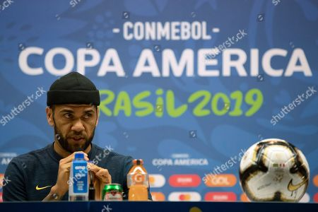 Brazil's Daniel Alves speaks during a press conference at the Maracana stadium in Rio de Janeiro, Brazil, . Brazil will face Peru for the Copa America title soccer match on Sunday