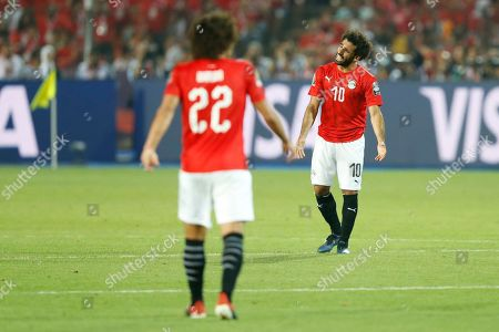 Egypt's Mohamed Salah reatcs to Egypt's Amr Warda after South Africa scored the goal during the African Cup of Nations round of 16 soccer match between Egypt and South Africa in Cairo International stadium in Cairo, Egypt, . South Africa won 1-0