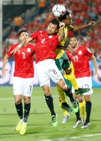 Egypt's Tarek Hamed, leftest, goes for the ball South Africa's Percy Tau during the African Cup of Nations round of 16 soccer match between Egypt and South Africa in Cairo International stadium in Cairo, Egypt