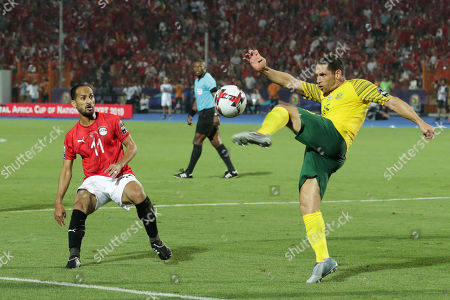 South Africa's Dean Furman, right, clears the ball past Egypt's Walid Soliman during the African Cup of Nations round of 16 soccer match between Egypt and South Africa in Cairo International stadium in Cairo, Egypt,. South Africa won 1-0