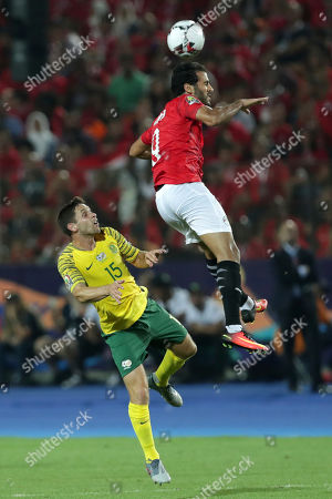 Egypt's Marwan Mohsen, right, heads the ball past South Africa's Dean Furman during the African Cup of Nations round of 16 soccer match between Egypt and South Africa in Cairo International stadium in Cairo, Egypt,. South Africa won 1-0
