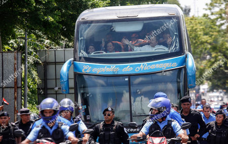 "Nicaragua's President Daniel Ortega and his wife Vice President Rosario Murillo look out from the top story of a bus as they make their annual pilgrimage to Masaya, marking the 40th anniversary of the Sandinista rebels ""tactical retreat"", in Managua, Nicaragua, . The ""Repliegue Tactico"", a military maneuver by the rebels, helped lead to the downfall of dictator Anastasio Somoza"