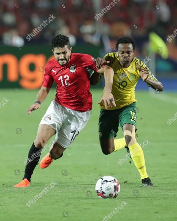 Stock Photo of Egypt's Ayman Ashraf (L) in action against South Africa's player Percy Tau (R) during the 2019 Africa Cup of Nations (AFCON) round of 16 soccer match between Egypt and South Africa at Cairo Stadium in Cairo, Egypt, 06 July 2019.