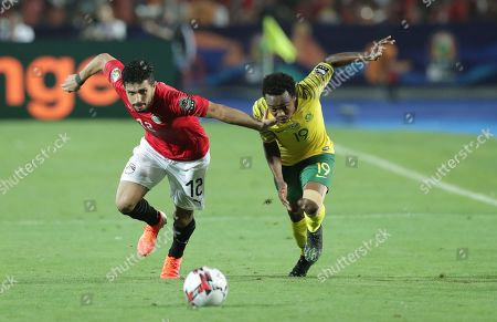 Egypt's Ayman Ashraf (L) in action against South Africa's player Percy Tau (R) during the 2019 Africa Cup of Nations (AFCON) round of 16 soccer match between Egypt and South Africa at Cairo Stadium in Cairo, Egypt, 06 July 2019.