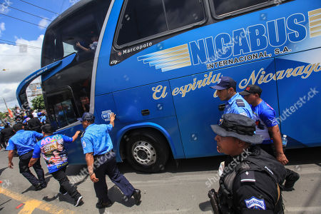 "National Police escort Nicaragua's President Daniel Ortega and his wife Vice President Rosario Murillo as they travel on on a bus to Masaya, marking the 40th anniversary of the Sandinista rebels ""tactical retreat"", in Managua, Nicaragua, . The ""Repliegue Tactico"", a military maneuver by the rebels, helped lead to the downfall of dictator Anastasio Somoza"