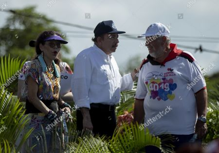 Nicaraguan president Daniel Ortega (C), Vice President Rosario Murillo (L) and Masaya's Mayor Orlando Noguera (R) participate in the 30km itinerary to commemorate the 40th anniversary of the 'tactical retreat' in Masaya, Nicaragua, 06 July 2019. The march from Managua to Masaya occured in 1979, when thousands walked to escape the National Guard of dictator Anastasio Somoza Debayle.