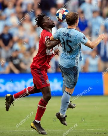 Seth Sinovic, C.J. Sapong. Sporting Kansas City defender Seth Sinovic (15) and Chicago Fire forward C.J. Sapong, left, compete for a head ball during the first half of an MLS soccer match in Kansas City, Kan