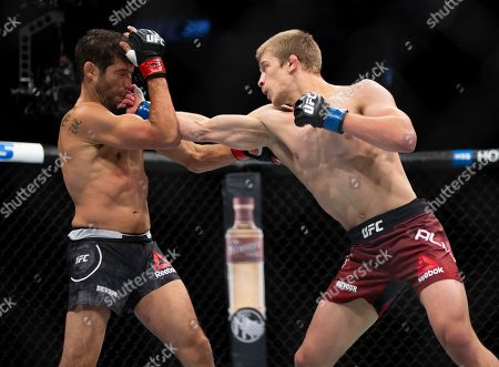Stock Image of Gilbert Melendez, left, takes a right from Arnold Allen during their featherweight mixed martial arts bout at UFC 239, in Las Vegas