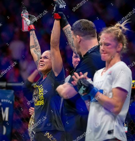 Amanda Nunes celebrates her knockout victory over Holly Holm during their women's bantamweight mixed martial arts title bout at UFC 239, in Las Vegas. Nunes won by first-round knockout
