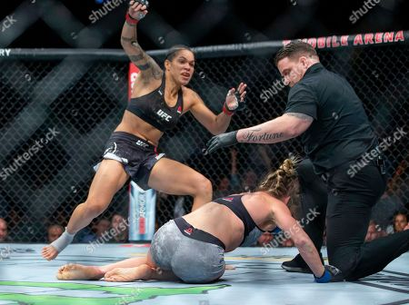 Referee Marc Goddard stops the fight after Amanda Nunes knocked out Holly Holm during their women's bantamweight mixed martial arts title bout at UFC 239, in Las Vegas. Nunes won by first-round knockout