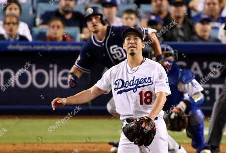 Hunter Renfroe, Kenta Maeda, Russell Martin. San Diego Padres' Hunter Renfroe watches his a solo home run odd Los Angeles Dodgers starting pitcher Kenta Maeda, foreground, during the seventh inning of a baseball game, in Los Angeles