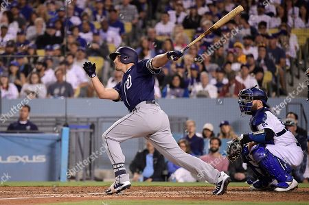 Hunter Renfroe, Russell Martin. San Diego Padres' Hunter Renfroe watches his solo home run next to Los Angeles Dodgers catcher Russell Martin during the seventh inning of a baseball game, in Los Angeles