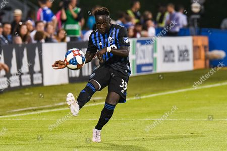 Montreal Impact defender Bacary Sagna (33) kicks the ball during the Minnesota United FC at Montreal Impact game at Saputo Stadium in Montreal, QC