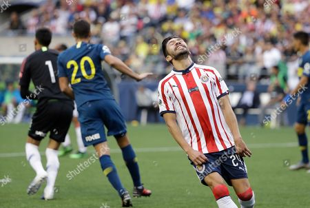 Chivas' Oribe Peralta reacts after missing a shot against Boca Juniors during the first half of a Colossus Cup soccer match, in Seattle