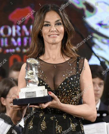 Maria Grazia Cucinotta poses with an award during the 65th annual Taormina Film Fest in Taormina, Sicily Island, Italy, 06 July 2019 (issued 07 July 2019). The festival runs from 30 June to 06 July.