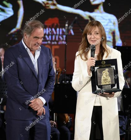 Filmmaker Svetlana Cvetko (R) receives the Cariddi D'Oro Award from US filmmaker Oliver Stone (L) for best movie, 'Show Me What You Got', during the 65th annual Taormina Film Fest in Taormina, Sicily Island, Italy, 06 July 2019 (issued 07 July 2019). The festival runs from 30 June to 06 July.