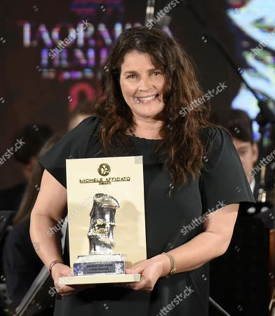 Julia Ormond poses with the Taormina Arte Award during the 65th annual Taormina Film Fest in Taormina, Sicily Island, Italy, 06 July 2019 (issued 07 July 2019). The festival runs from 30 June to 06 July.