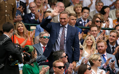 Stock Picture of David Hempleman-Adams stands up after being introduced to the crowd on Centre Court during day six of the Wimbledon Tennis Championships in London
