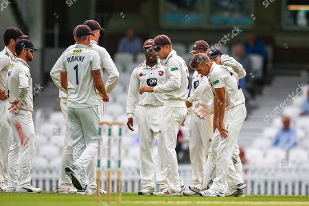 Wicket! Gareth Batty of Surrey bowled out lbw by Matt Milnes of Kent who celebrate with his team during the Specsavers County Champ Div 1 match between Surrey County Cricket Club and Kent County Cricket Club at the Kia Oval, Kennington