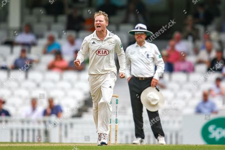 Wicket! Gareth Batty of Surrey celebrates taking the wicket of Heino Kuhn of Kent during the Specsavers County Champ Div 1 match between Surrey County Cricket Club and Kent County Cricket Club at the Kia Oval, Kennington