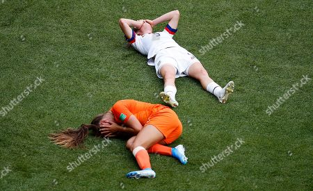 Netherlands' Lieke Martens and United States' Kelley O Hara lie on the pitch during the Women's World Cup final soccer match between US and The Netherlands at the Stade de Lyon in Decines, outside Lyon, France