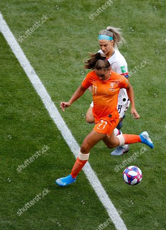 Netherlands' Lieke Martens, front, and United States' Julie Ertz challenge for the ball during the Women's World Cup final soccer match between US and The Netherlands at the Stade de Lyon in Decines, outside Lyon, France