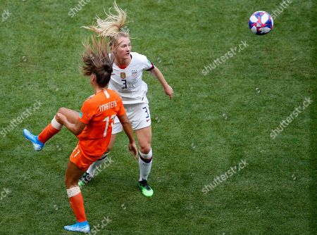 Netherlands' Lieke Martens, left, and United States' Samantha Mewis challenge for the ball during the Women's World Cup final soccer match between US and The Netherlands at the Stade de Lyon in Decines, outside Lyon, France