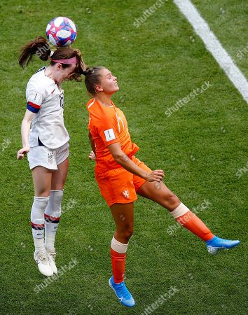 Netherlands' Lieke Martens, right, and United States' Rose Lavelle challenge for the ball during the Women's World Cup final soccer match between US and The Netherlands at the Stade de Lyon in Decines, outside Lyon, France