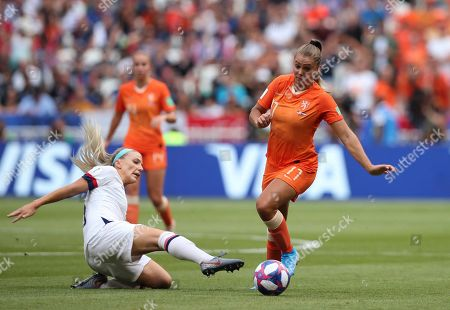 United States' Julie Ertz tackles Netherlands' Lieke Martens, right, during the Women's World Cup final soccer match between US and The Netherlands at the Stade de Lyon in Decines, outside Lyon, France