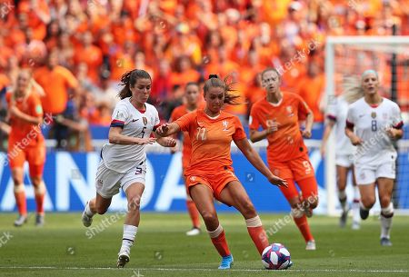United States' Kelley O Hara, center left, vies for the ball with Netherlands' Lieke Martens during the Women's World Cup final soccer match between US and The Netherlands at the Stade de Lyon in Decines, outside Lyon, France