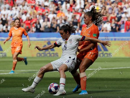 Netherlands' Lieke Martens, right, challenges United States' Kelley O Hara, left, during the Women's World Cup final soccer match between US and The Netherlands at the Stade de Lyon in Decines, outside Lyon, France