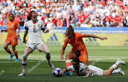 United States' Rose Lavelle, left, watches as Netherlands' Lieke Martens, center, challenges United States' Kelley O Hara, right, during the Women's World Cup final soccer match between US and The Netherlands at the Stade de Lyon in Decines, outside Lyon, France