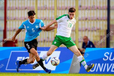 Ireland vs Uruguay. Ireland's Simon Falvey with Diego Martin Bonaudi Melgar of Uruguay