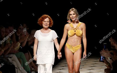 Spanish designer Dolores Cortes (L) and Spanish model Agueda Lopez (R) greet the audience after presenting her creations from the Spring-Summer 2020 collection during the 70th Mercedes-Benz Fashion Week Madrid, in Madrid, Spain, 07 July 2019. The MBFWM runs from 05 to 10 July.