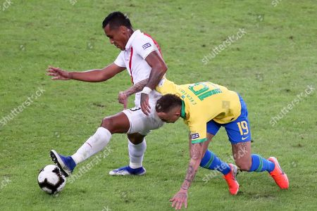 Stock Picture of Peru's Aldo Corzo, left, and Brazil's Everton battle for the ball during the final soccer match of the Copa America at the Maracana stadium in Rio de Janeiro, Brazil