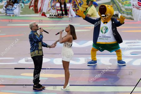 Anitta, of Brazil, and Pedro Capo, of Puerto Ricod, sing prior to the final soccer match of the Copa America between Brazil and Peru at the Maracana stadium in Rio de Janeiro, Brazil