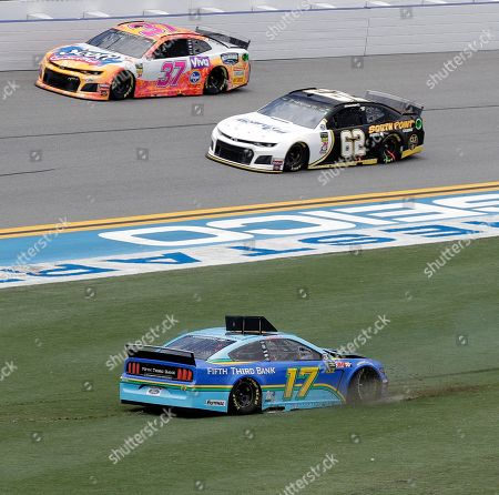 Ricky Stenhouse Jr., Chris Buescher, Brendan Gaughan. Ricky Stenhouse Jr. (17) slides backwards after making contact with another car coming out of Turn 4 as Brendan Gaughan (62) and Chris Buescher (37) go past during a NASCAR Cup Series auto race at Daytona International Speedway, in Daytona Beach, Fla